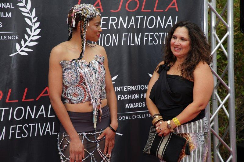 Natasha Cobb, in a dress designed by Monique Guzman, right