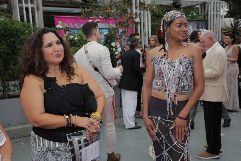 Natasha Cobb, right, in a dress designed by Monique Guzman, left