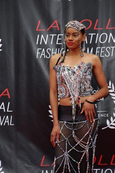 Natasha Cobb in a dress designed by Monique Guzman